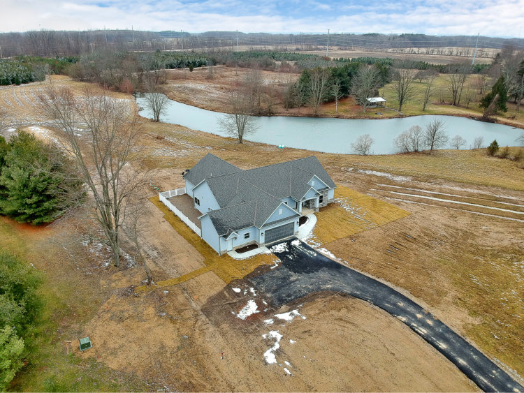 custom home builder coppertree homes built the sunbury ranch on the pond 15