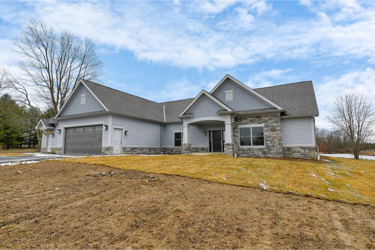 custom home builder coppertree homes built the sunbury ranch on the pond 5